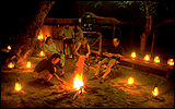 Enjoy tasty meals under the stars - and the dancing flames of the camp fire in the African bush.